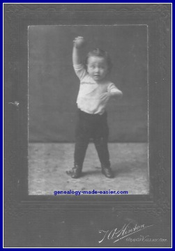 Young boy with ball in 1907
