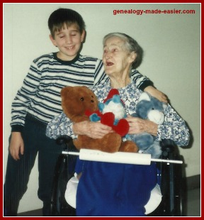 Young Boy Giving his Great Grandmother Cuddly Toys