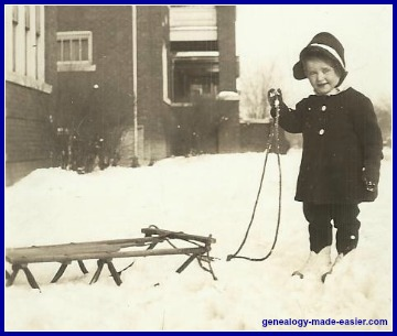 Little girl with sled in snow