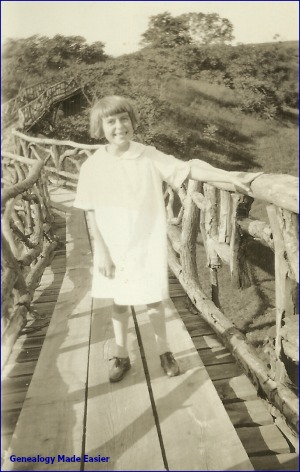 Young girl on the golf course bridge